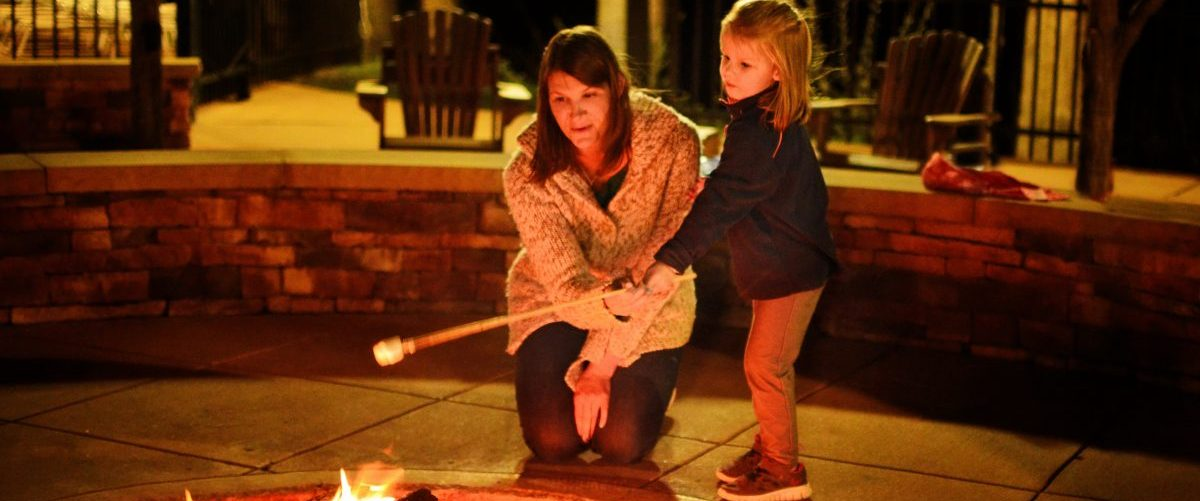 Mother and daughter roasting marshmallow, Fayetteville, West Virginia