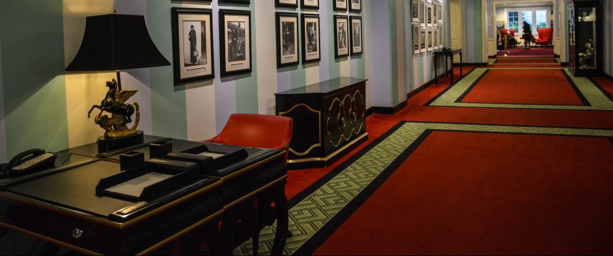 Carpeted hallway with pegasus lamp, The Greenbrier Resort, West Virginia