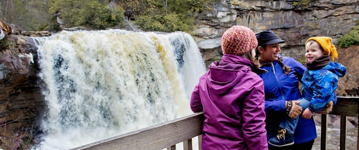mountain traditions to share with your family. A young child visits Blackwater Falls from platform, WV