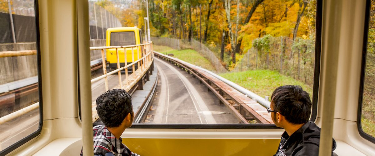 Two students riding the PRT in Morgantown, WV