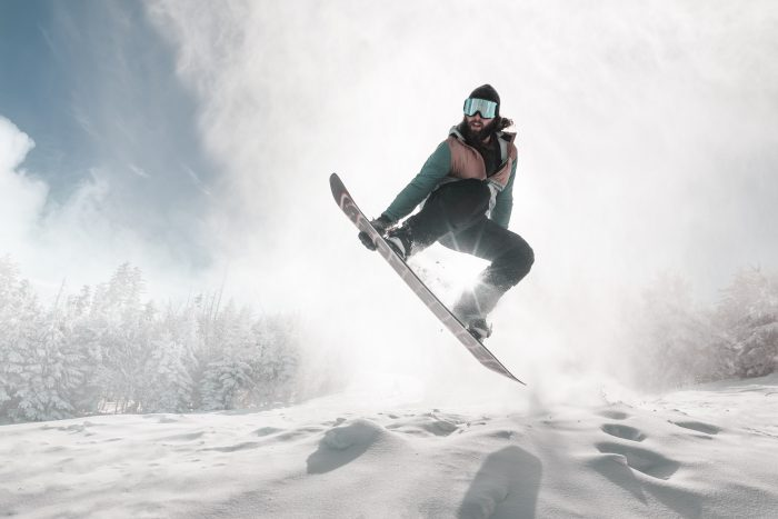 A snowboarder in the air at Snowshoe