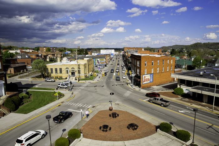 View of four-street intersection in downtown Princeton, West Virginia with a blue, cloudy sky